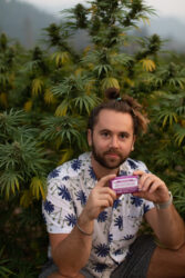 East Fork Cultivars - Farmer Nathan holding a bar of Sun+Earth Cannabis-Scented Soap wrapped with Purple Dr. Bronner's label